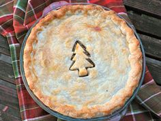 Classic Tourtiere  I add cloves, nutmeg, veal, and grated potato and use butter instead of olive oil. For a traditional meal served once a year a little butter won't hurt ;)