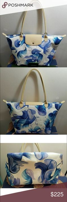 """Longchamp Le Pliage Splash Large Cornflower Blue Brand new Made in FRANCE. This is a SOLDOUT item!!! Comes with original Longchamp packaging envelop, care booklet and packaging paper and receipt.  Splash Large Shoulder Tote Bag, CornflowerLongchamp tote bag in iconic """"Splash"""" brushstroke-print cotton canvas with leather trim.Tubular shoulder straps; 9"""" drop.Zip top with golden Longchamp racehorse medallion pull.Racehorse-embossed flap snaps closed at front.Inside, unlined; one open…"""