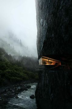 Amazing photo of home on side of rock structure / mountain
