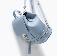 We {love} this powder blue Zara backpack!