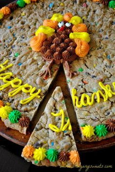 Thanksgiving Cookie Cake- a giant chocolate chip and m&m cookie cake with buttercream frosting! #Thanksgiving #cookie www.shugarysweets.com