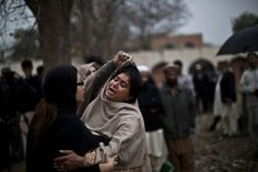 Muhammed Muheisen—AP Mar. 3, 2014. A woman grieves outside a hospital's morgue for victims of a twin suicide bombing in Islamabad, Pakistan....