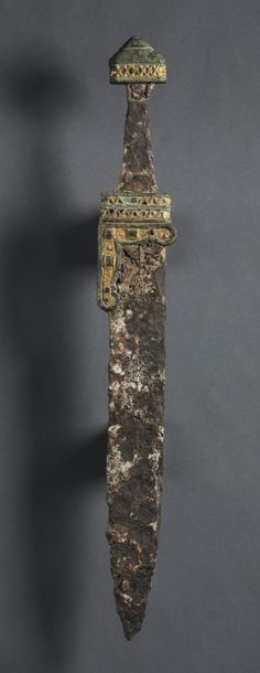 Single-Edged Knife (Scramasax), c. 500-700 Merovingian, Migration period, 6th-7th Century iron, brass, gold foil, gold wire, gemstones, Overall - h:54.31 w:6.35 cm (h:21 3/8 w:2 1/2 inches).