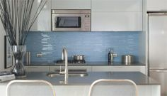 Glass tile backsplash, I would love to have this as a focal point behind the range with white subway tile surrounding the rest of the kitchen.