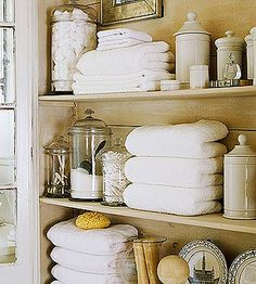 """I'm always on the hunt for white things to place on a shelf or next to a pile of books.  And I'm always changing our vignettes around.  Getting your accessories from many different sources (in different styles and price points) makes for that """"collected over time"""" feel.  I'm also fascinated with finishes that aren't quite """"perfect.""""   by simply seleta, via Flickr"""