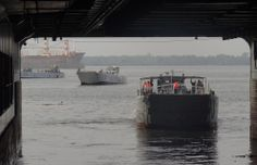 Light landing craft returning to well deck of French Marine Nationale BPC Dixmunde, Jan 2014, at Abidjan, Côte d'Ivoire.