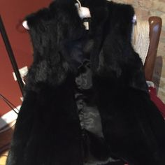 Michael Kors black fur vest Size small gorgeous black fur vest, never worn Michael Kors Jackets & Coats Vests