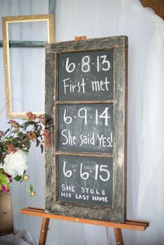 Jennifer and Jeremy married almost exactly two years from their first meeting, which they noted on a chalkboard sign displayed at their reception.