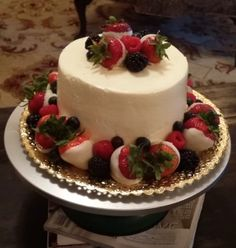 Vanilla Bean cake with a bavarian cream filling and buttercream frosting.  Hand dipped strawberries covered in white chocolate along with raspberries and blueberries added a wonderful finishing touch,   So Yummy