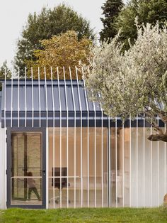 The facade of this private guesthouse in northern Spain extends out to become a fence