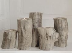 Driftwood logs, cut up and made into tea light holders.