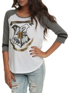 Raglan top with a gold foil accented Hogwarts crest and grey sleeves. 50% cotton; 50% polyester- Listed in junior sizes.