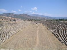 The typical hippodrome was carved into a hillside and the material pulled from the ground was packed along the edges to construct an embankment for seats. Its shape was oblong, with one end semicircular and the other squared – similar to a 'U', but with a closed top. Pictured are the ruins of a hippodrome in Aphrodisias, Turkey