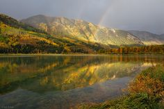 Beaver Lake Rainbow  Marble, Colorado    A double rainbow reflects in Beaver Lake, near the town of Marble, on a rainy September morning.   Photo © copyright by Jack Brauer.