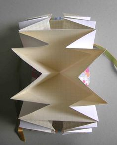 DIY origami paper pocket fold book (see post for the bag she made using this idea)