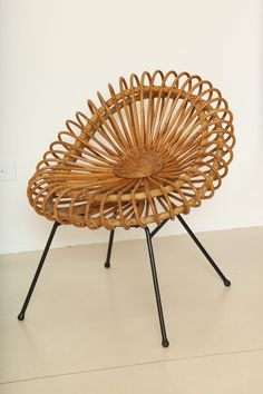 // Janine Abraham and Dirk Jan Rol; Rattan and Enameled Metal 'Corolles' Chair for Rougier and SIR, 1957.