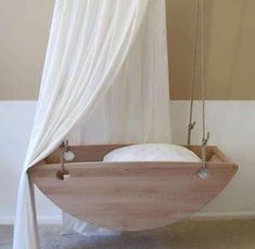 35 Suspended Cradles, Modern Baby Room Ideas and Inspirations for DIY Hanging Beds. Contemporary, yet natural, baby cradle. Seriously out of the box cool. Suspended baby cradles are modern baby room furniture designs inspired by traditional cradles Hanging Beds, Diy Hanging, Hanging Cradle, Hanging Bassinet, Hanging Chairs, Baby Furniture, Furniture Stores, Children Furniture, Furniture Websites