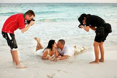Del Sol Photography, Matt and Sol double teaming to get that great beach trash the dress shot