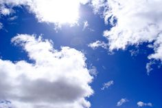 Sunny blue skies with white clouds.
