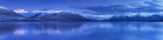 """Lake Heron New Zealand  I did this image for a bit of fun. The actual scene is a blue hour shot taken on a freezing morning with a dusting of snow having fallen the afternoon prior. There were faint stars but not at the same time of day . I've been editing a few panorams for the Epson panorama awards and this one won't be one of them entered but I hope you like the fantasy element to it!  <a href=""""http://www.facebook.com/everlookphotography"""">[Facebook]</a>  <a…"""