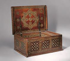 Wooden scribe's cabinet, Spain, Al-Andalus, Nasrid, 15th century. Walnut wood inlaid with bone, metal, wood, and mother-of-pearl
