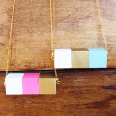 A little paint and some common jewelry findings transform these craft-store wooden blocks into a chic necklace!