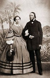 Civil War era lady with great dress, undersleeves and holding her hat...