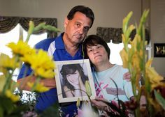 Debbie and Alan Hunter stand with flowers sent for the drug related death of their 21-year-old daugh... - Ron T. Ennis/Fort Worth Star-Telegram/MCT