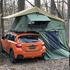 Nice Compact Tent Topped Subaru Car Camper setup. Photo by Scotty Chopss