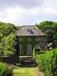 Love this stone house. Amazing windows and doors.