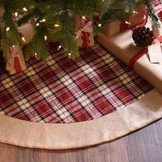 Give your beautifully wrapped presents a festive back drop with our Red Tartan Plaid Christmas Tree Skirt. With bright red hues and burlap accents, this festive tree skirt has a classic, Christmas look. Farmhouse Christmas Tree Skirts, Diy Christmas Tree Skirt, Xmas Tree Skirts, Christmas Tree Skirts Patterns, Tartan Christmas, Christmas Sewing, Plaid Christmas, Rustic Christmas, Christmas Crafts