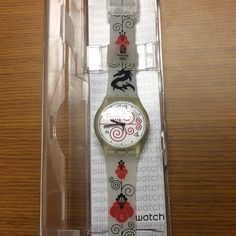 Swatch Watch SUJK131 Good Destiny Olympics Dragon The SUJK131 Good Destiny has the same design features as the Olympic torch from the 2008 Beijing Olympics. On the plastic strap you find the dragon, which is a potent symbol of auspicious power. The transparent plastic case surrounds the dial which has a design of lucky clouds. A black hour, minute and second hand mark the time.   Brand new, in box with plastic cover still on the face.  New battery installed.  Water resistant:3 Bar Length of…