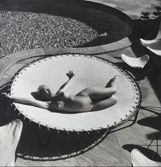 Andre De Dienes - Marilyn Monroe lying naked on a trampoline, 1953. … via Art & Photo
