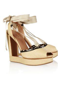 Alaïa fluid cutout woven raffia wedge sandals