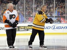 Honorary captains Bobby Clarke, a former Philadelphia Flyers great, and Bobby Orr, a former Boston Bruins legend, meet at center ice before the New Year''s Day Winter Classic, played outdoors