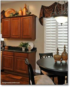 kitchen simple clean above cupboard decor 2 vases a plate - Decorations On Top Of Kitchen Cabinets