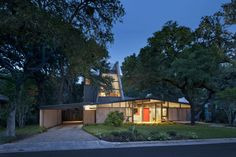 Midcentury home in Austin with second-story addition.