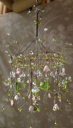 Make your own garden mobile. Wire/ recycled crystals