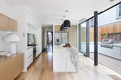 Light and airy with a hint of glam - A terrace home in Melbourne has been re-imagained for a new way of living.