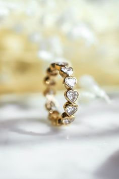 The abundant heart diamond bezel eternity ring exuberates love and compassion. If you love a heart shaped diamond, this is the ring for you. Depending on the finger size, the number of stones may vary, but no matter the finger size the eternity ring is continually shining with joy. Heart Shaped Diamond, Eternity Ring, Heart Shapes, Fine Jewelry, Jewelry Design, Wedding Rings, Engagement Rings, Stone, Handmade