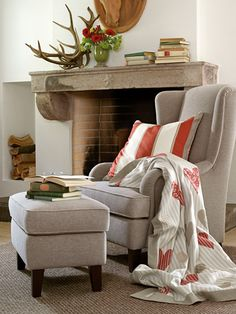 Love the coral and grey! Great color combo for a subdued beachy feel! I could see my mom curled up in this chair with her kindle and cup of joe! I also absolutely love the detail of the cutout niche in the wall for stacks of wood. So cozy and inviting!