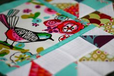 """An asymmetrical block with part fussy-cut bird and part traditional block using Alexander Henry """"Larkspur"""" fabric. (From My Full Color Life blog)"""