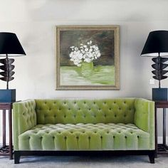 Tufted Couch on feature wall downstairs