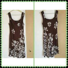 """Women's Brown & White Sleeveless Floral Dress  Women's gorgeous brown & white floral sleeveless dress with cute knot tie in front upper chest area on both sides. Worn one time only and freshly dry cleaned. No inner lining. Like new condition.  Chest is 34"""", waist is 36"""", and total center length from top of shoulder strap to bottom hem is 42"""". Disclaimer: I sell on many different sites so items may move fast.  Items purchased are mailed the next day.  I do not sell anything I myself would not…"""