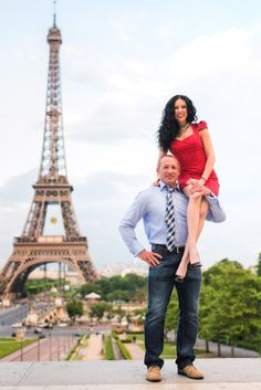 Couple truly having fun at the Eiffel Tower in Paris.