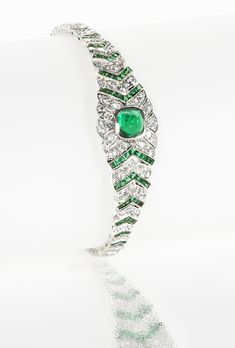 Art Deco Diamond, Emerald and Platinum Bracelet (=)
