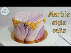 Learn how easy it is to marbleize fondant. This beginner fondant project will make you look like a pro. Stay Sweet, Subscribe: http://s.wilton.com/10vmhuv Yo...