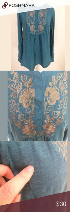 Meadow Rue Anthropologie Embroidered Knit Top Meadow Rue Anthropologie Blue Embroidered Collar Long Sleeve Knit Top Medium.  Excellent condition. There is a white string woven in on the side. See photos. Long sleeves with tabs to roll them up. Clean and comes from smoke free home. Questions welcomed. Anthropologie Tops