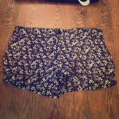 Floral Miley Cyrus Max shorts Brown, white, and yellow floral shorts. The size are jr 11 but I wear a standard size 4 and these fit me. No tags but I have never worn them. Also they have cute pockets that are hard to see in the pictures. Shorts