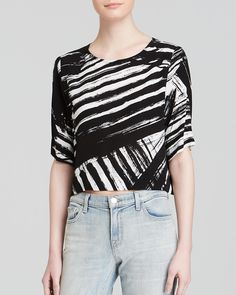 Monochrome fashion will never go out of style. We love this black and white top from Bloomingale's! Shop on Mavatar, it's on sale!